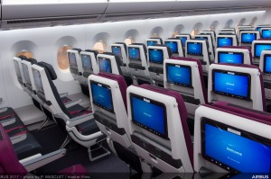 Economy class on board a Qatar Airways Airbus A350. The airline has increased flights to Australia as other carriers ...