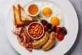 English breakfast with fried egg, sausage, bacon, beans and toast on white background copy space iStock image for ...