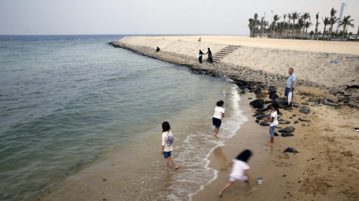 People visit the Red Sea beach, in Jiddah.