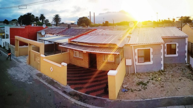 Elevated panoramic view of Cape Town Langa housing area at twilight.