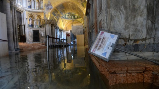 A view of the flooded interior of St. Mark's Basilica.
