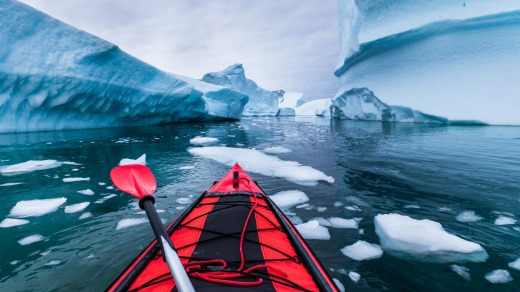 Kayaking in Antarctica between icebergs.