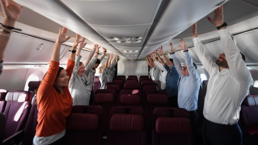 Passengers do exercises on board to help combat jet lag.