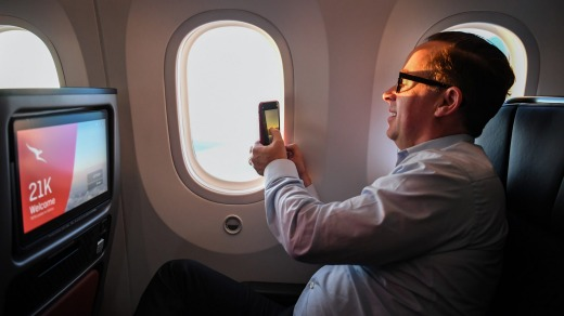 Qantas CEO Alan Joyce snaps a photo of the sunrise during the flight.