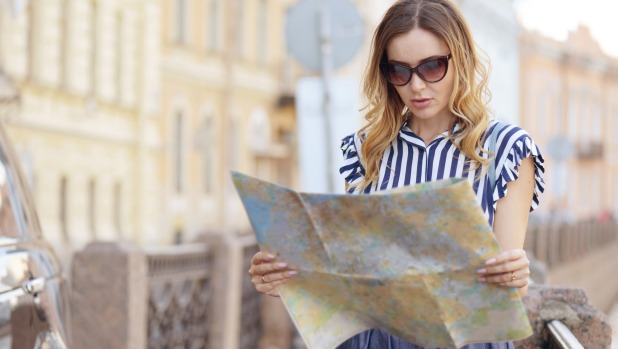 A tourist grapples with an old-school map.