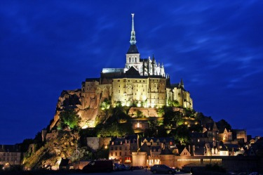 MONT ST MICHEL, NORMANDY: Perched on a rocky islet surrounded by sandbanks that are exposed to powerful tides between ...