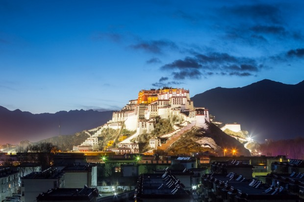 POTALA PALACE, LHASA: Ringed by the mountains of Tibet, the former official residence of the Dalai Lama and one of the ...