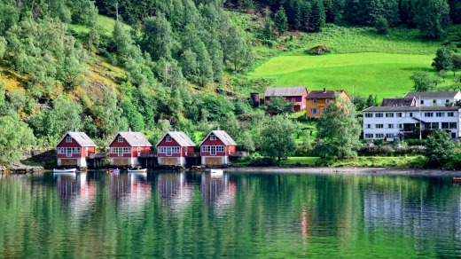 Huts along the coastline of Flam, Norway.