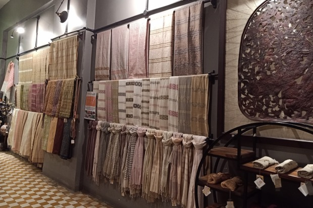KHMER ARTISANRY  Lush Khmer silks sit alongside traditional cotton weaves in this shop that is helping keep traditional ...
