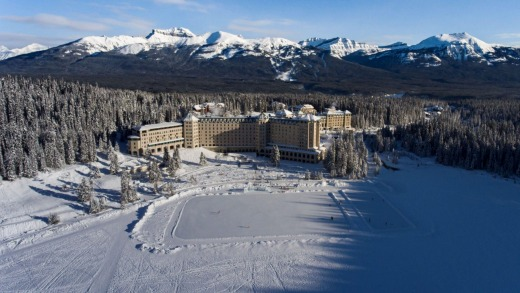 The impressive Fairmont Chateau Lake Louise on the edge of the lake, with skating rink created on the lake.