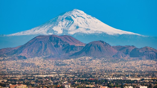 View of the snow covered Popocatepetl volcano as seen from Mexico City.