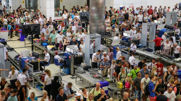 Either you love the airport experience or hate it: Security lines at Antalya International Airport, Turkey.