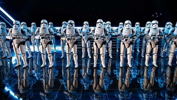Inside a hangar bay of a Star Destroyer, 50 Stormtroopers greet riders on Rise of the Resistance