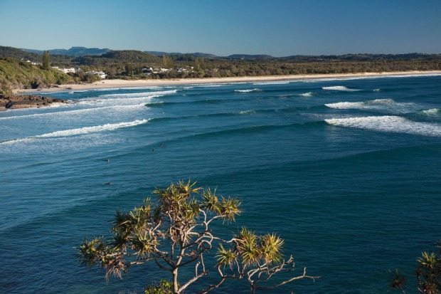 Surfers catching a morning wave at Cabarita Beach, Northern Rivers.