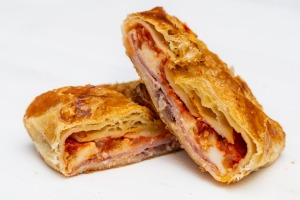 Sicilian Cipolline: A typical Sicilian street food made with olives, tomato, ham, onion and cheese.