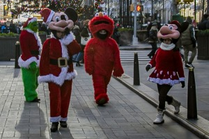 Costumed performers have moved from Times Square to the Rockefeller Center during the Christmas season.