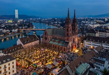 CHRISTMAS MARKETS, BASEL, SWITZERLAND: The sweet aroma of mulled wine and roasting chestnuts drifts through the crisp ...