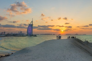 Burj Al Arab and Jumeirah Beach Hotel at sunset.