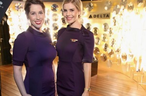 Delta flight attendants attend Delta Air Lines' Grammys party last year. A group of flight attendants is suing over the ...