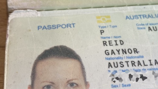 The small tear at the top left of Gaynor Reid's passport photo page was the problem.