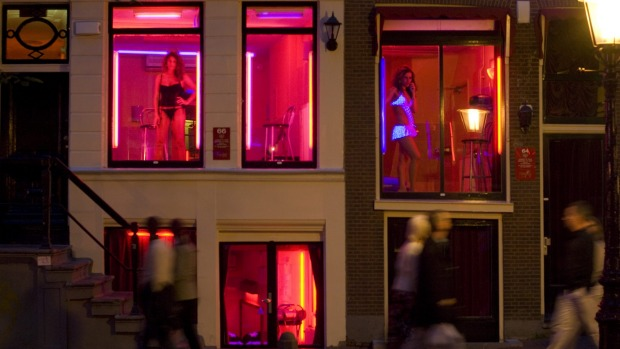 The red-light district windows of sex workers have become a tourist attraction.