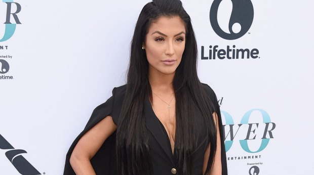 Natalie Eva Marie has slammed Qantas on social media after being refused entry to the business lounge at Melbourne Airport.