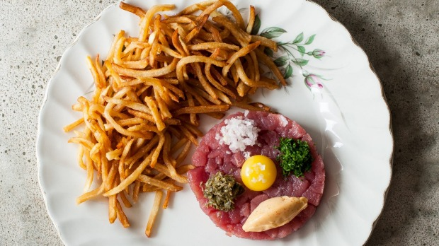 Bar Kismet's famous ahi tuna tartare, loaded with capers, quail egg yolk and spicy mayo and served with a heart-stopping ...