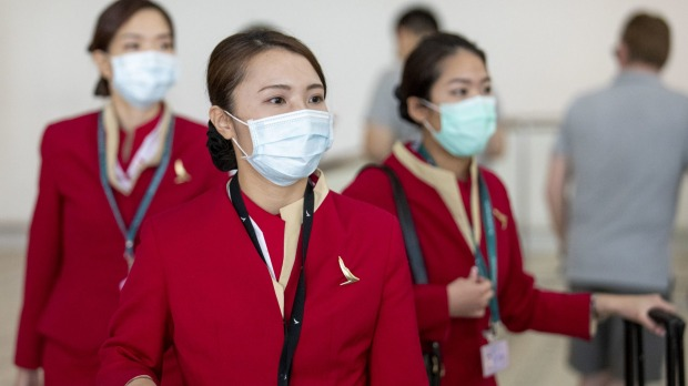 Cathay Pacific flight attendants wearing face masks at Brisbane Airport.
