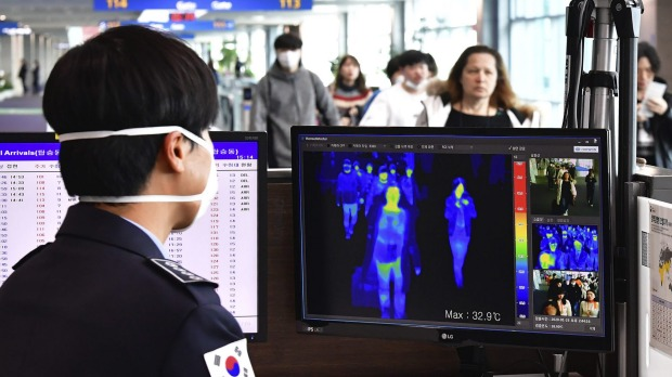 A thermal camera checks the temperature of passengers arriving at Incheon International Airport in South Korea.