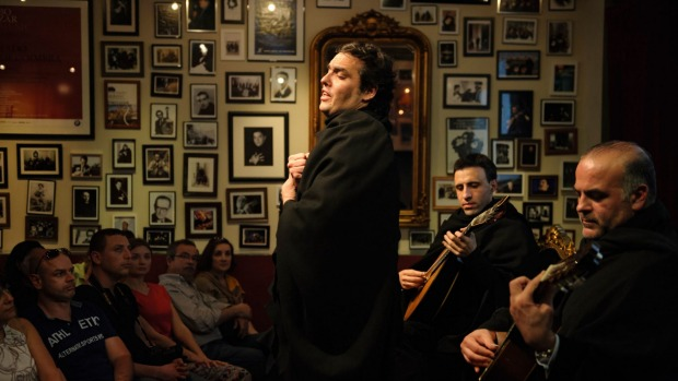 A Fado singer and musicians in Portugal.