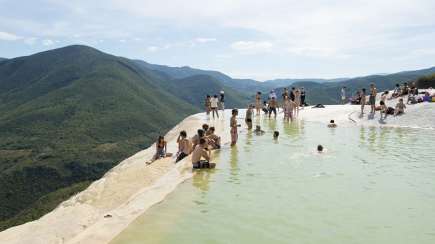 Tourists enjoy the water and dramatic scenery at Hierve el Agua in Oaxaca State, Mexico.