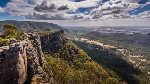 Looking out over the valley and mountains below from the Pinnacles Lookout in the Grampians, Victoria.