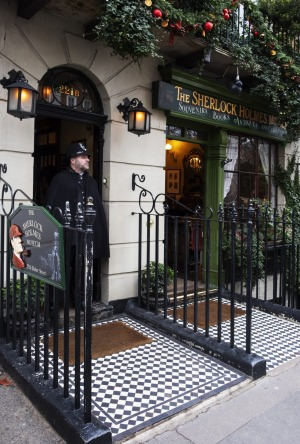 A policeman stands at the entrance to the Sherlock Holmes Museum, at the mythical 221B of Baker Street in London, United ...