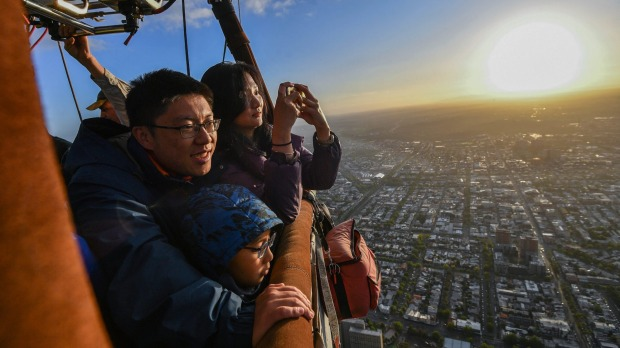Wei Chen, Zhu Yi Qi with their son Zhu Si Yun were the last Chinese tourists to take a trip with Melbourne's Global ...
