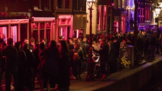 Tours of the red-light district still will be allowed if guides stick to the new restriction, which takes effect in ...