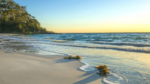 A beach in Huskisson, a town in Jervis bay marine park famous for white sand beaches,  whale watching, fishing and swimming.