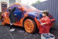Children painting cars at The Museum of Play and Art (MoPA), Geelong.