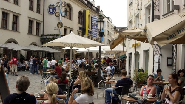 Restaurants and shops on the streets of Munich old town.