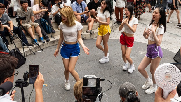 Young Korean women dance to K-Pop in Hongdae, a hip district popular with students.