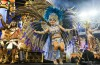 Members of Perola Negra Samba School perform on top of a float during the parade at Anhembi Sambadrome of Sao Paulo.