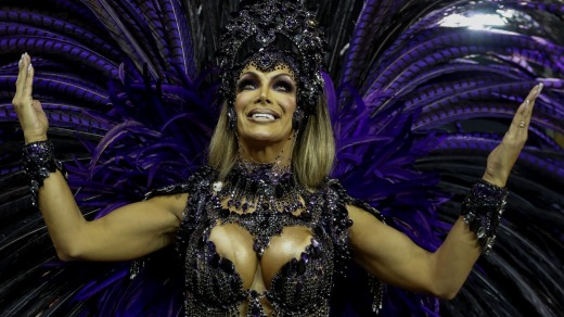 Transgender godmother Camila Prins poses for pictures prior to performing for Colorado do Bras samba school in Sao Paulo.