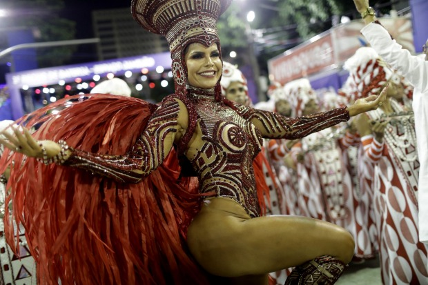A performer from the Viradouro samba school parades during Carnival celebrations at the Sambadrome in Rio de Janeiro.