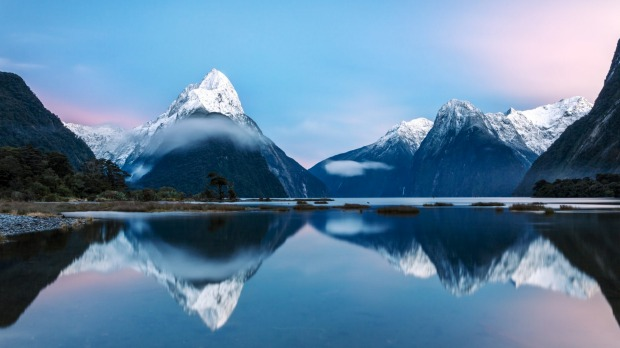 Awesome sunrise over Mitre peak and mountains of Milford Sound, Fiordland National Park, Southland, New Zealand ...