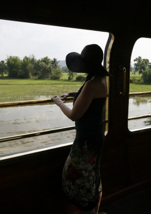 An Eastern and Oriental passenger takes in the Thai countryside.