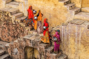 Women gathering water from a stepwell in Amer, near Jaipur,