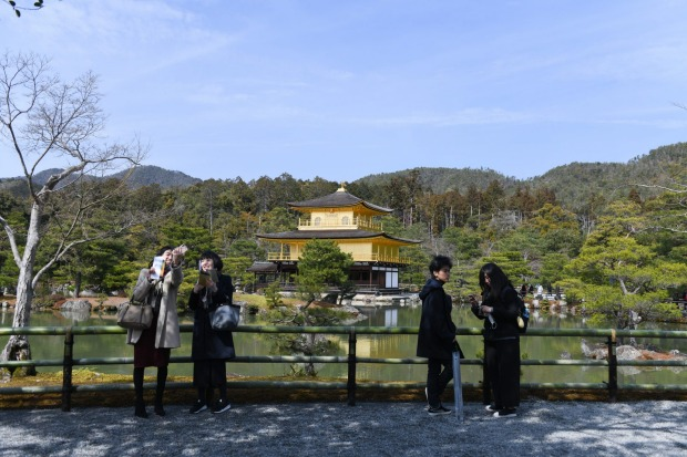 Few visitors head to the normally crowded Kinkaku-ji temple in Kyoto, Japan. The outbreak of the virus has slammed the ...
