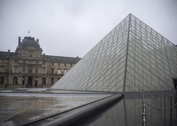The entrance to the Louvre Museum in Paris, France, is empty. The most popular and busiest museum in the world has been ...