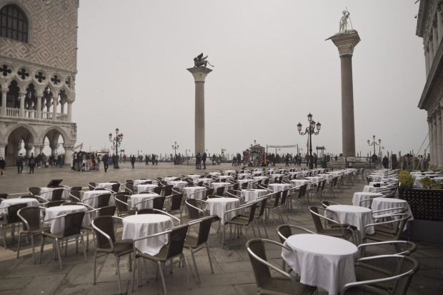 The restaurants of St. Mark's square are empty.