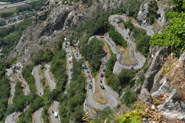 Spectators line the narrow, twisting, turning, switchbacking roads as the world's best cyclists struggle up. Alpe De ...