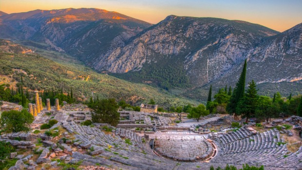 Sunset view of ruins of theatre at ancient Delphi, Greece.